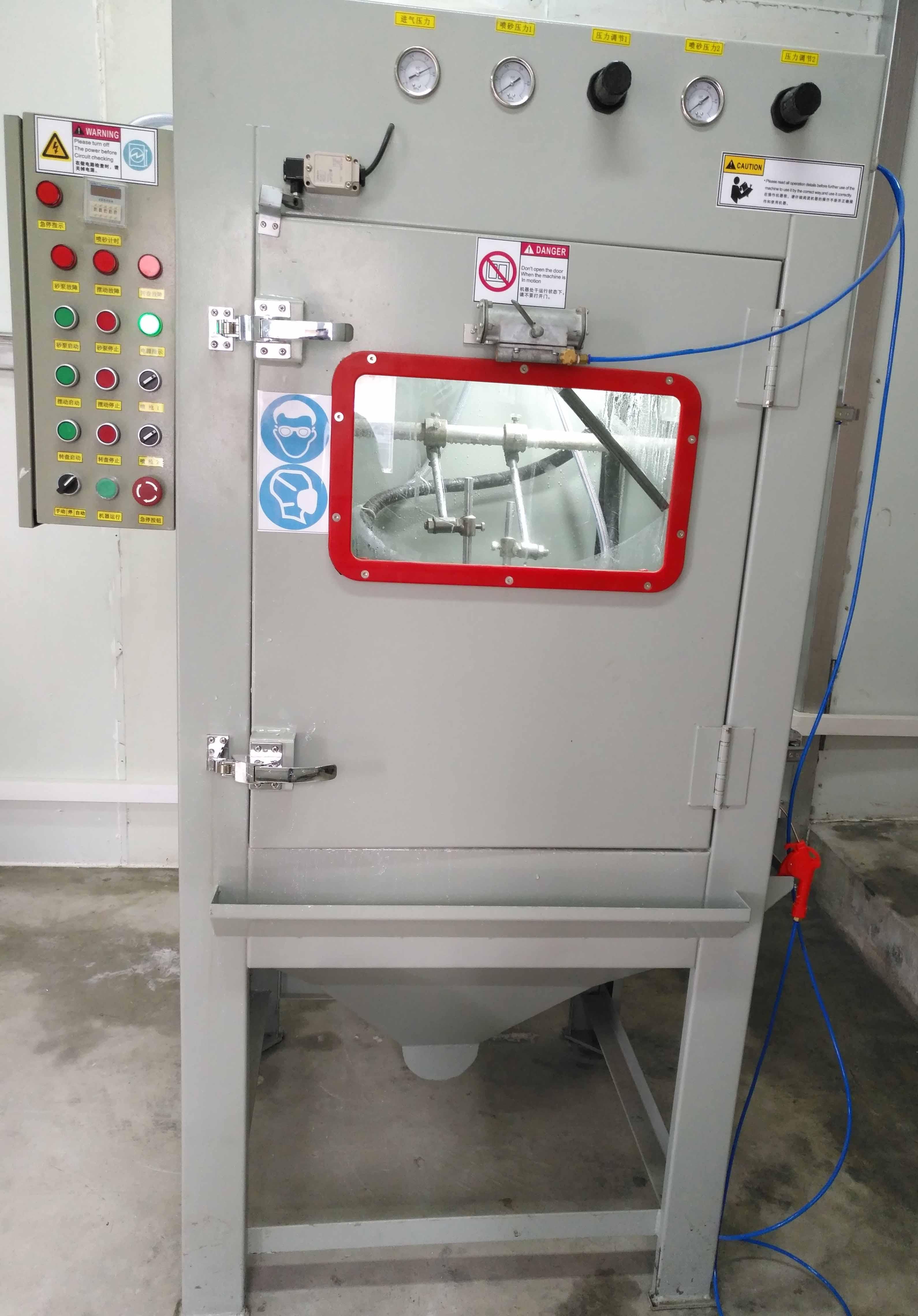为贵州某厂设计制作的液体非标自动喷砂机